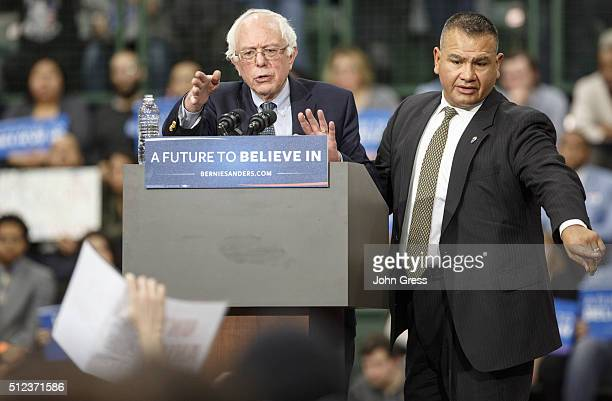Democratic presidential candidate Sen Bernie Sanders is joined by a Secret Service agent during a protest as Sanders campaigns at Chicago State...