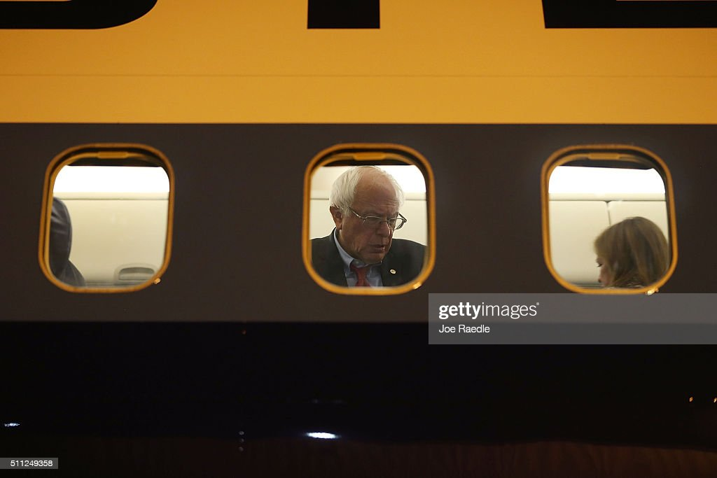 Democratic presidential candidate Sen. Bernie Sanders is seen through the window of his plane on the tarmac at Signature Flight Support as he continues to campaign on February 18, 2016 in Las Vegas, Nevada. The Nevada Democratic caucus is February 20.