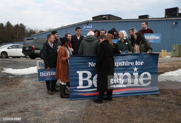 Democratic presidential candidate Sen Bernie Sanders is surrounded by supporters after arriving in New Hampshire on February 04 2020 in Des Moines...