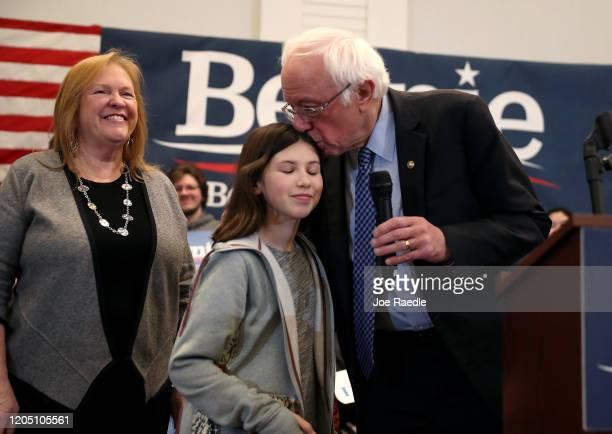 Democratic presidential candidate Sen. Bernie Sanders kisses his granddaughter, Tess Driscoll, as his wife, Jane Sanders, looks on before he speaks...