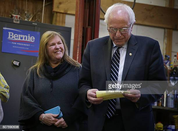 Democratic presidential candidate Sen Bernie Sanders listens to introduction with his wife Jane O'Meara Sanders at a campaign event at a private...