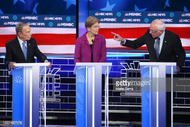 Democratic presidential candidate Sen Bernie Sanders makes a point as Sen Elizabeth Warren and former New York City mayor Mike Bloomberg listen...