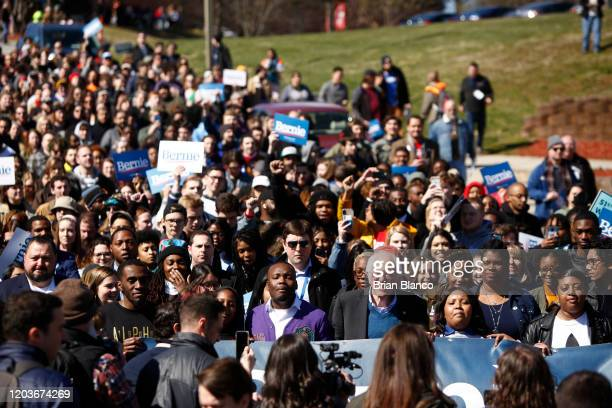Democratic presidential candidate Sen Bernie Sanders marches with supporters to early vote on February 27 2020 at WinstonSalem State University in...
