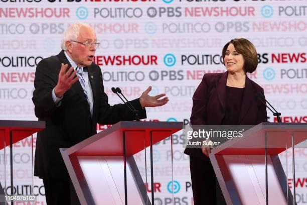 Democratic presidential candidate Sen Bernie Sanders reacts to Sen Amy Klobuchar during the Democratic presidential primary debate at Loyola...