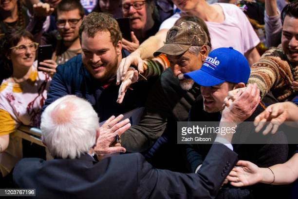 Democratic presidential candidate Sen Bernie Sanders shakes hands with supporters as he wraps up a rally at the Arthur Ashe Junior Athletic Center on...