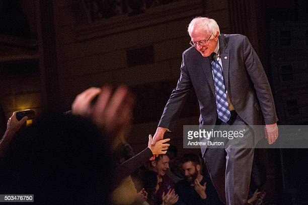 Democratic presidential candidate Sen Bernie Sanders shakes hands with supporters after outlining his plan to reform the US financial sector on...