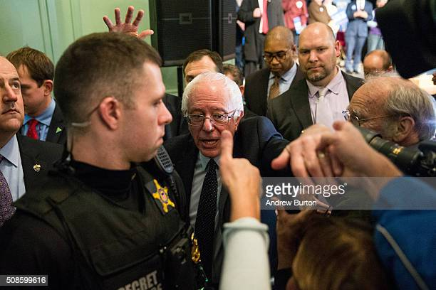 Democratic presidential candidate Sen Bernie Sanders shakes hands with audience members after speaking at a rally in the Exeter town hall on February...
