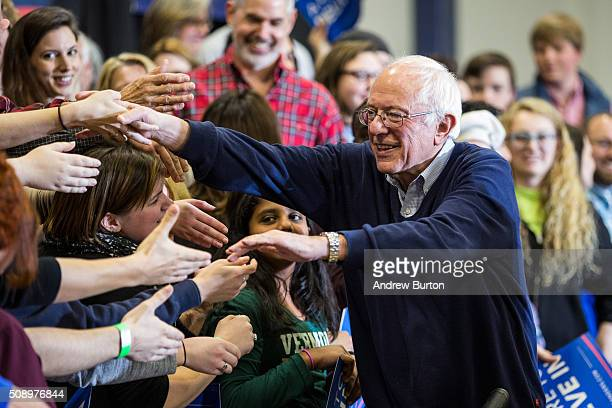 Democratic presidential candidate Sen Bernie Sanders shakes hands with audience members after speaking at a campaign rally at Great Bay Community...