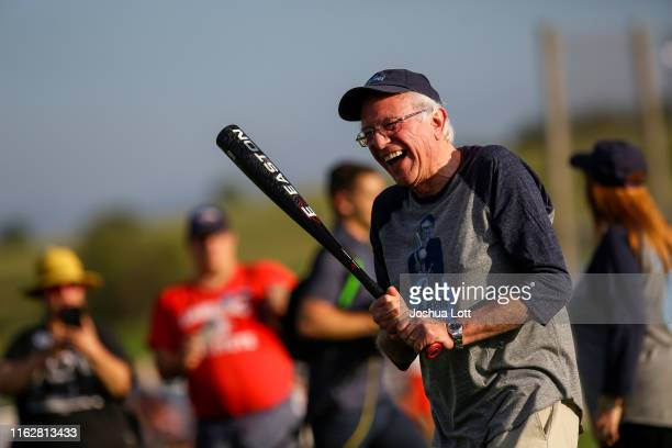 Democratic presidential candidate Sen. Bernie Sanders shares a laugh as he warms up before his baseball game against the Leaders Believers Achievers...
