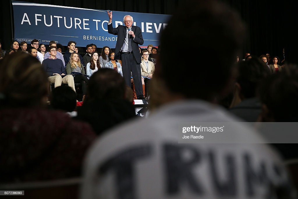 Democratic presidential candidate Sen. Bernie Sanders (I-VT) speaks, as a Donald Trump for President supporter sits in the audience wearing a tee-shirt with his name on it, during a forum at Roosevelt High School on January 28, 2016 in Des Moines, Iowa. The Democratic and Republican Iowa Caucuses, the first step in nominating a presidential candidate from each party, will take place on February 1.