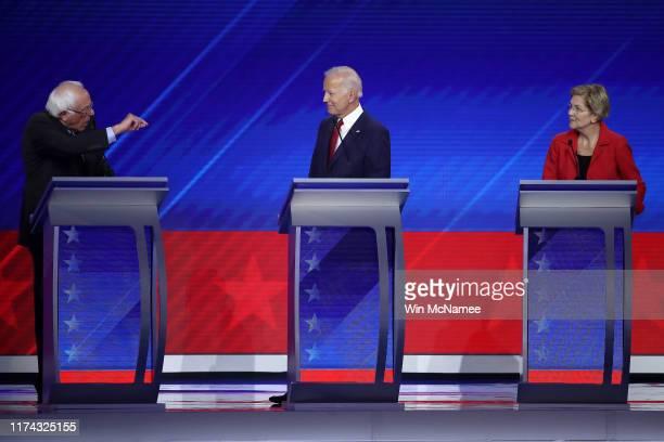 Democratic presidential candidate Sen. Bernie Sanders speaks as former Vice President Joe Biden and Sen. Elizabeth Warren look on during the...