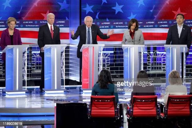 Democratic presidential candidate Sen. Bernie Sanders speaks as Sen. Elizabeth Warren , Sen. Kamala Harris , and Andrew Yang listen during the...