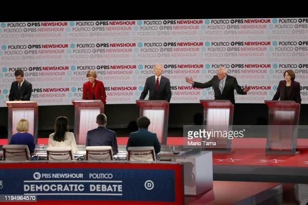 Democratic presidential candidate Sen Bernie Sanders speaks as South Bend Indiana Mayor Pete Buttigieg Sen Elizabeth Warren former Vice President Joe...