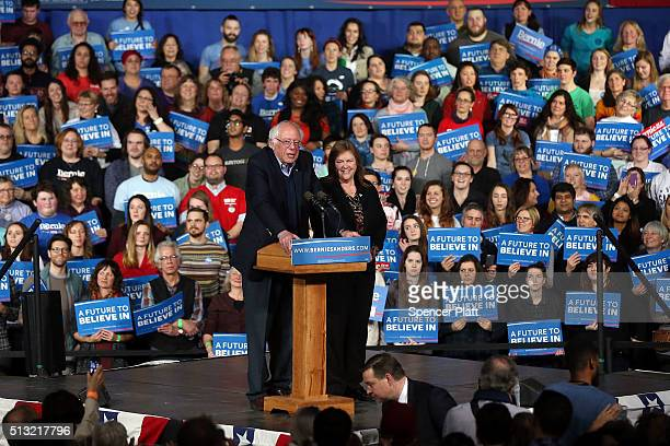 Democratic presidential candidate Sen Bernie Sanders speaks to supporters as his wife Jane O'Meara Sanders looks on after winning the Vermont primary...