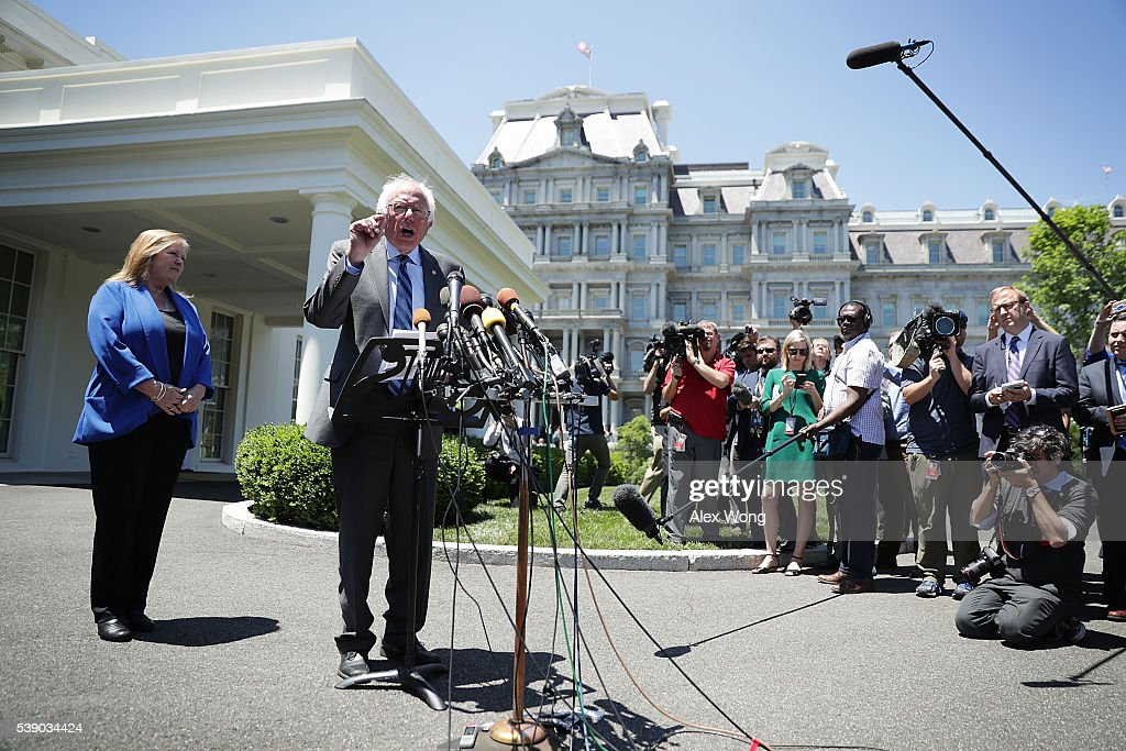 Democratic presidential candidate Sen. Bernie Sanders (D-VT) speaks to members of the media as his wife Jane O'Meara Sanders looks on after an Oval Office meeting with President Barack Obama at the White House June 9, 2016 in Washington, DC. Sanders met with President Obama after Hillary Clinton has clinched the Democratic nomination for president.