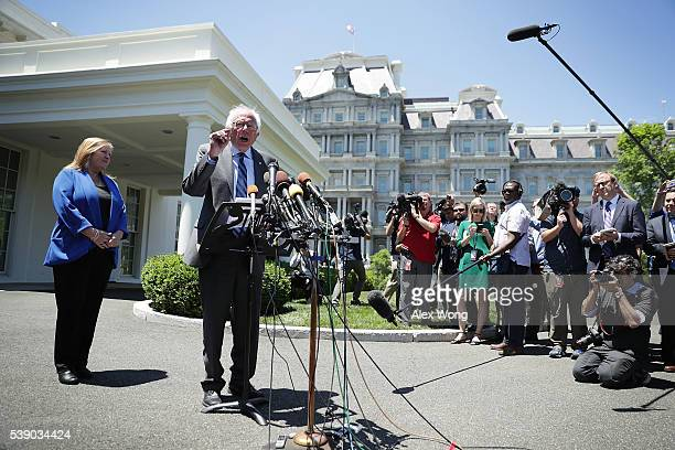 Democratic presidential candidate Sen Bernie Sanders speaks to members of the media as his wife Jane O'Meara Sanders looks on after an Oval Office...