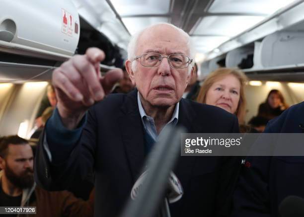 Democratic presidential candidate Sen Bernie Sanders speaks to the media after boarding the plane at the Des Moines International Airport on February...