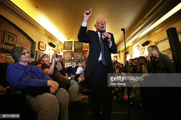 Democratic presidential candidate Sen Bernie Sanders speaks to voters during a campaign event at Cafe Dodici January 29 2016 in Washington Iowa...
