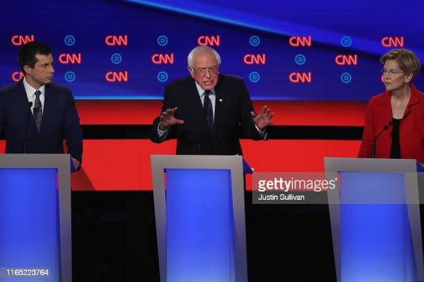 Democratic presidential candidate Sen Bernie Sanders speaks while South Bend Indiana Mayor Pete Buttigieg and Sen Elizabeth Warren listen during the...