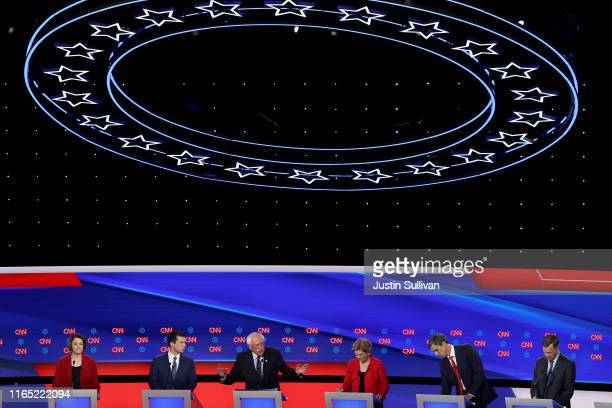 Democratic presidential candidate Sen Bernie Sanders speaks while Sen Amy Klobuchar South Bend Indiana Mayor Pete Buttigieg Sen Elizabeth Warren...