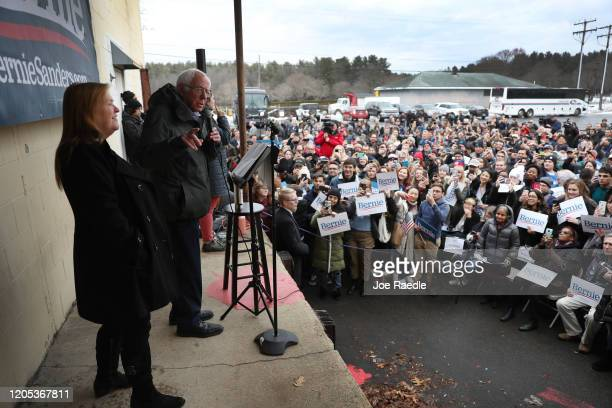 Democratic presidential candidate Sen. Bernie Sanders standing with his wife, Jane Sanders, speaks during a get out the vote event at a field office...