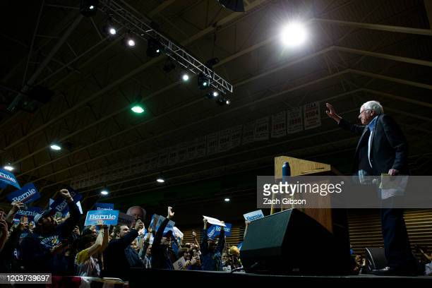 Democratic presidential candidate Sen Bernie Sanders takes the stage before speaking during a rally at the Arthur Ashe Junior Athletic Center on...