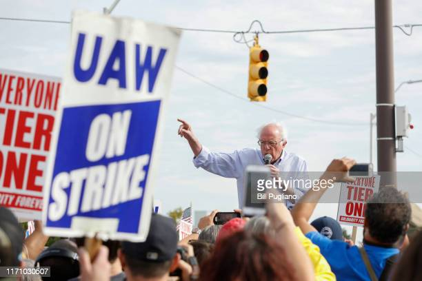 Democratic presidential candidate Sen Bernie Sanders visits striking United Auto Workers union members as they picket at the General Motors...