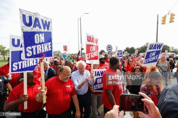Democratic presidential candidate Sen Bernie Sanders walks the picket line with striking United Auto Workers union members as they picket at the...