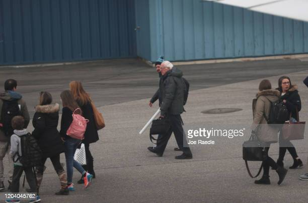 Democratic presidential candidate Sen Bernie Sanders walks to his vehicle after arriving in New Hampshire on February 04 2020 in Manchester New...