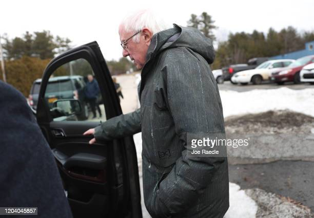 Democratic presidential candidate Sen Bernie Sanders walks to his vehicle after greeting people that turned out to meet him after he landed on...