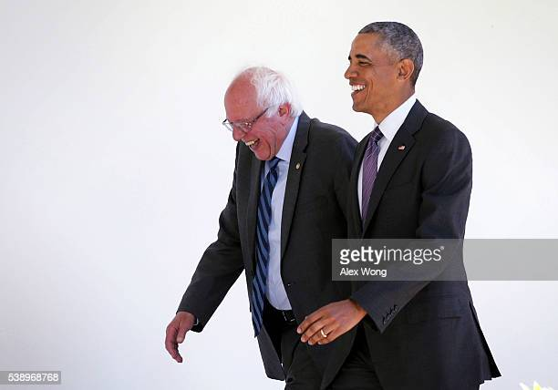 Democratic presidential candidate Sen Bernie Sanders walks with President Barack Obama through the Colonnade as he arrives at the White House for an...