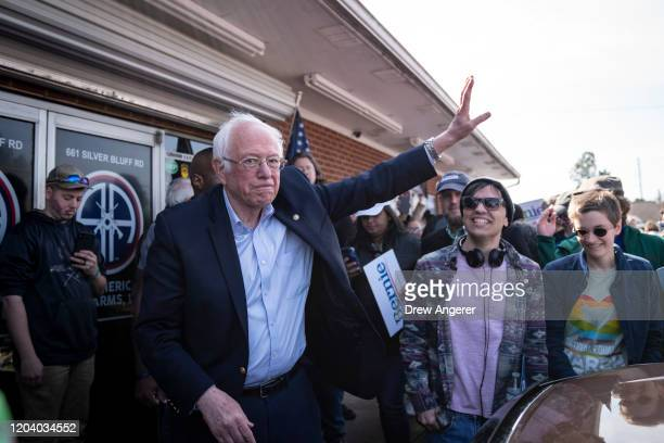 Democratic presidential candidate Sen Bernie Sanders waves as he leaves a campaign rally on February 28 2020 in Aiken South Carolina South Carolina...