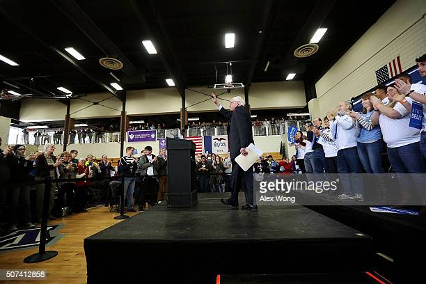 Democratic presidential candidate Sen Bernie Sanders waves as he arrives at a town hall style meeting at Iowa Wesleyan University January 29 2016 in...