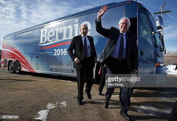 Democratic presidential candidate Sen Bernie Sanders waves as he arrives at a campaign rally at the Delaware County Fairgrounds January 30 2016 in...