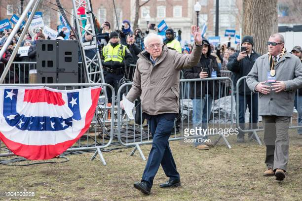 Democratic presidential candidate Sen Bernie Sanders waves as he arrives to a campaign rally on the Boston Common on February 29 2020 in Boston...