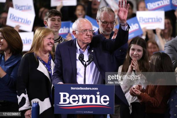 Democratic presidential candidate Sen Bernie Sanders waves to supporters as his wife Jane Sanders smiles at his Super Tuesday night event on March 03...