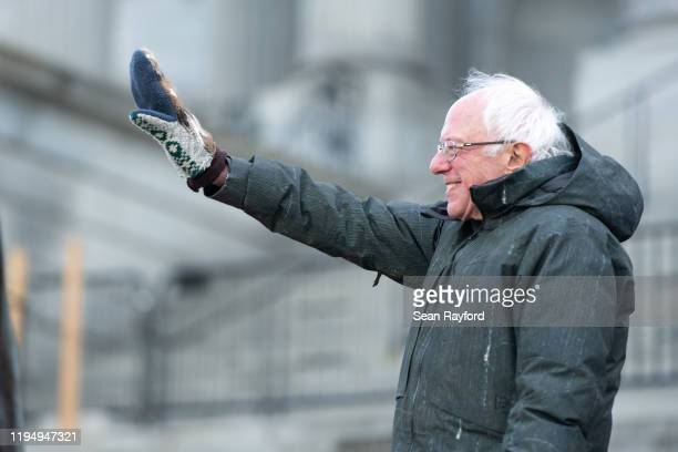 Democratic presidential candidate Sen Bernie Sanders waves to the crowd during King Day at the Dome March and Rally on January 20 2020 in Columbia...