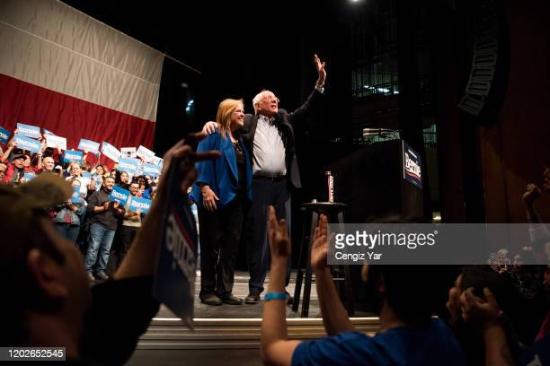 Democratic presidential candidate Sen Bernie Sanders waves to the crowd alongside his wife Mary Jane O'Meara Sanders at a campaign rally on February...