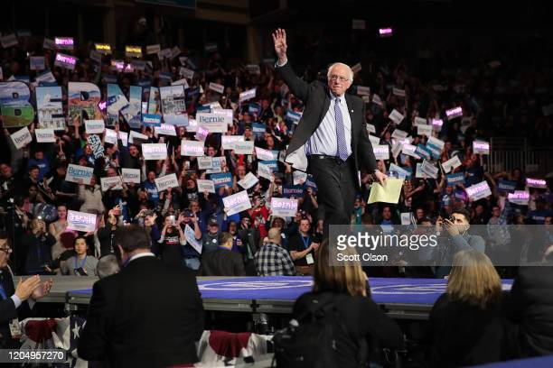 Democratic presidential candidate Sen Bernie Sanders waves to the crowd during the 100 Club Dinner at SNHIU on February 08 2020 in Manchester New...