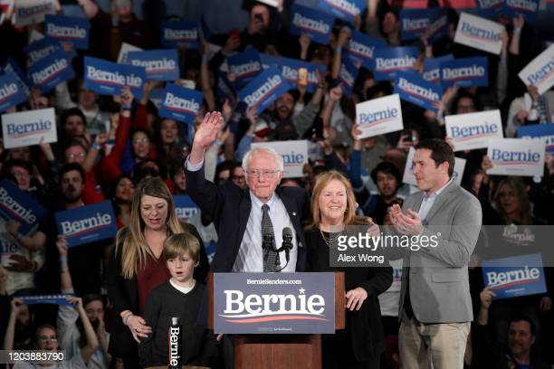 Democratic presidential candidate Sen Bernie Sanders with his wife Jane Sanders and family addresses supporters during his caucus night watch party...