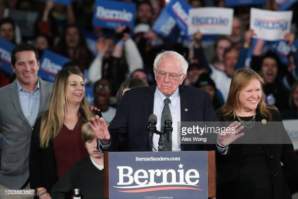 Democratic presidential candidate Sen. Bernie Sanders with his wife Jane Sanders and family addresses supporters during his caucus night watch party...