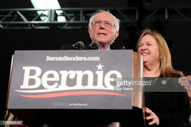 Democratic presidential candidate Sen Bernie Sanders with wife Jane Sanders addresses supporters during his caucus night watch party on February 03...