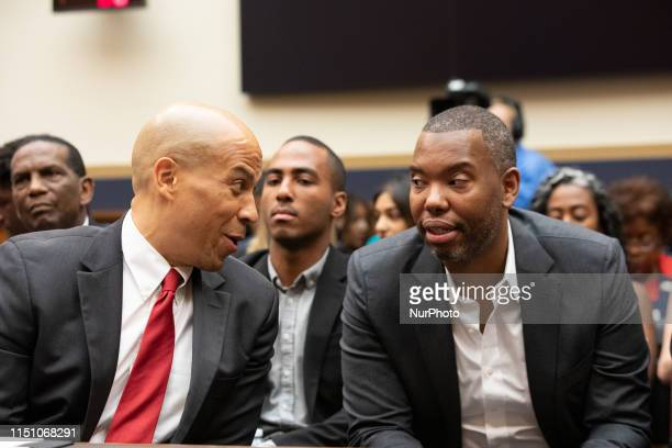 Democratic Presidential candidate Sen. Cory Booker, D-NJ, speaks to writer and journalist Ta-Nehisi Coates, before testifying about reparations for...