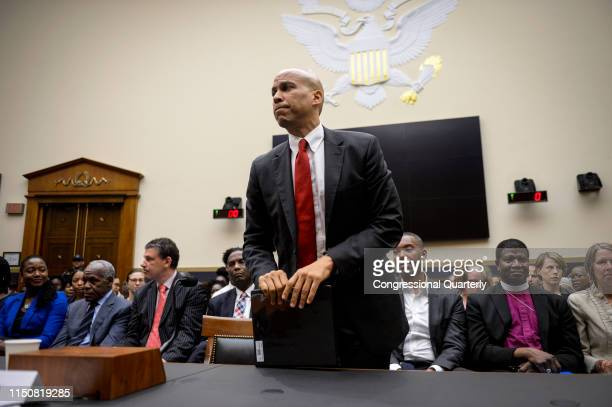 Democratic Presidential candidate Sen. Cory Booker, D-NJ, stands up after testifying about reparations for the descendants of slaves during a hearing...