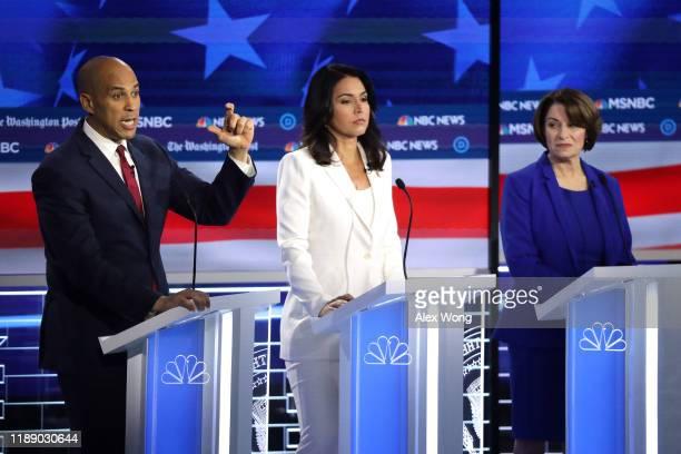 Democratic presidential candidate Sen. Cory Booker speaks as Rep. Tulsi Gabbard and Sen. Amy Klobuchar listen during the Democratic Presidential...