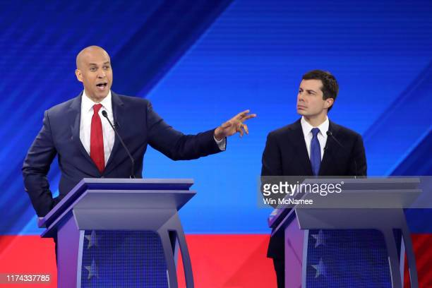Democratic presidential candidate Sen Cory Booker speaks as South Bend Indiana Mayor Pete Buttigieg looks on during the Democratic Presidential...