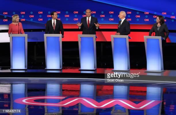 Democratic presidential candidate Sen Cory Booker speaks while Sen Kirsten Gillibrand and former housing secretary Julian Castro former Vice...
