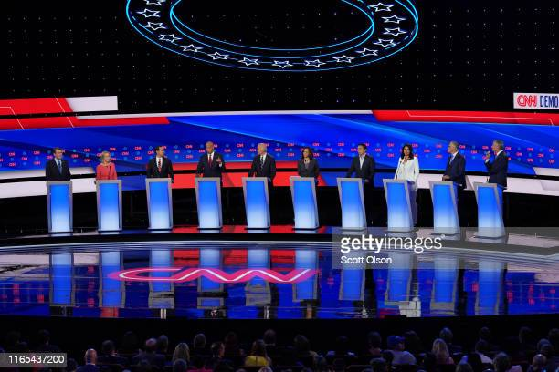 Democratic presidential candidate Sen Cory Booker speaks while Sen Michael Bennet Sen Kirsten Gillibrand former housing secretary Julian Castro...