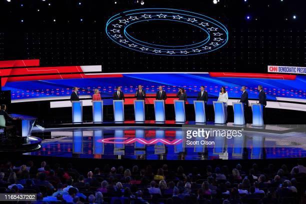 Democratic presidential candidate Sen Cory Booker speaks while Sen Michael Bennet Sen Kirsten Gillibrand former housing secretary Julian Castro...