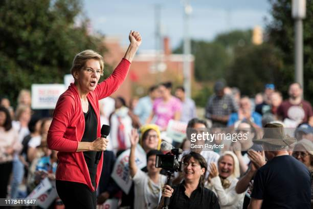 Democratic presidential candidate Sen Elizabeth Warren addresses a crowd outside of the Francis Marion Performing Arts Center October 26 2019 in...
